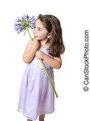 Pretty girl holding a flower