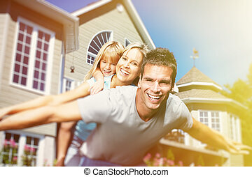 Happy family near the house - Happy smiling family with...