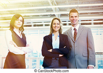 Bussiness team of three persons in office