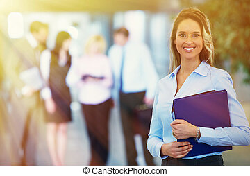 Bussinesswoman over team background - Young smiling pretty...