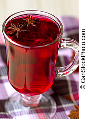Red Tea (karkade) with anisetree in a transparent glass...