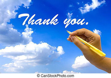Hand writing thank you on blue sky.