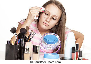 preparing for bedtime - girl wipes mascara and eye make-up...