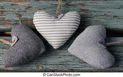 Three Hearts - Three fabric shabby chic heart on wooden...