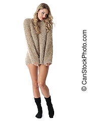 Model Released. Sexy Young Woman Wearing a Jumper and Socks