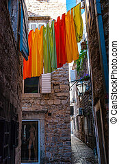 fresh linen on line in mountains - clean linen on city...