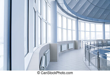 windows and columns in the rounded interior of modern office...