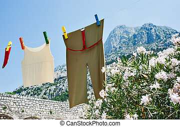 fresh linen on line  - clean linen on blue sky background