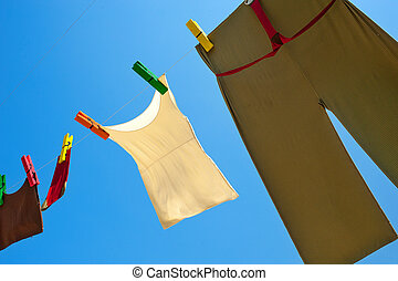 fresh linen on line in mounteins - clean linen on blue sky...