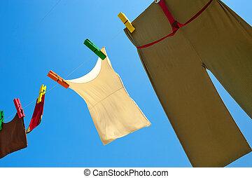 fresh linen on line in mounteins - clean linen on blue sky...