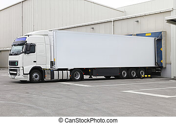 Truck and trailer - White box semi trailer at warehouse...