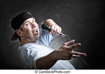 Rap singer man with microphone cool hand gesture - Rapper...