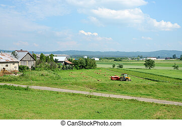 Tractor plowing the field in spring,Poland