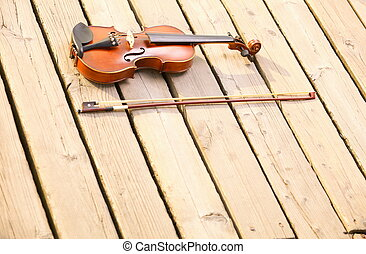 Violin on wooden pier. Music concept