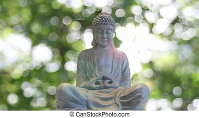 Bronze Buddha on Bokeh Background - Bronze Buddha Sculpted...