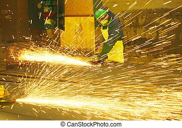 Industrial artisans grinding sheet metal - Industrial...