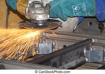 Grinder throwing sparks off a steel structure