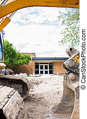 Local School construction - A backhoe sits framing the photo...