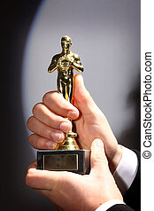 Fake Oscar prize - The winner holds in his hand the award...
