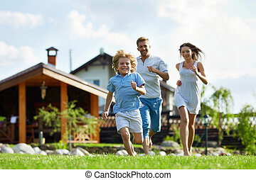 Expression - Running people on a lawn at the house
