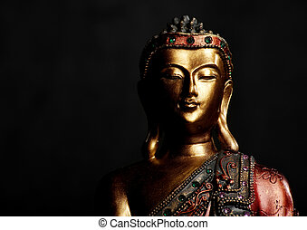 Buddha Statue on Dark Background - Golden Buddha statue on a...