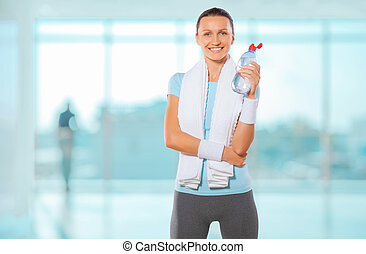 a sportswoman with bottle of water