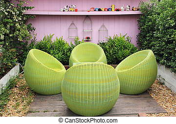 garden Rattan furniture - Rattan furniture on lawn in a...