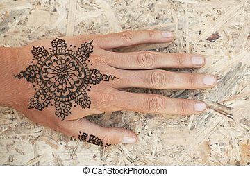 Mehendi - The Indian pattern is drawn a girl