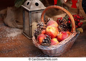 Fresh red apple with christmas toys in the basket