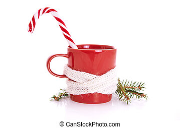 chistmas theme - red mug and candy cane over white...