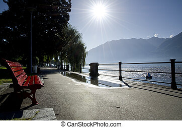 Lakefront with mountain and sun