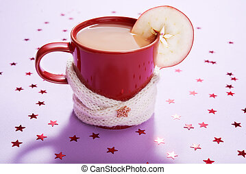 chistmas theme - red mug of tea over lilac background with...