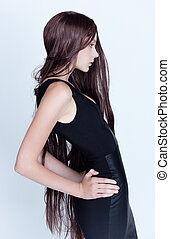 Long-haired brunette - Studio photo of a young woman with...