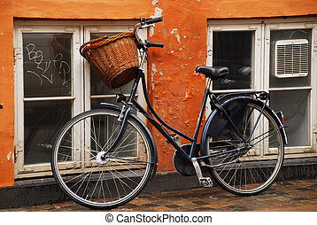 Bicycle leaning against a wall,Copenhagen,Denmark