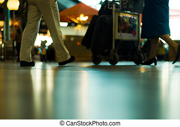 people traveling at the airport (Blurry!)