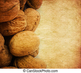 Walnuts background - Close up of scattered whole walnuts on...