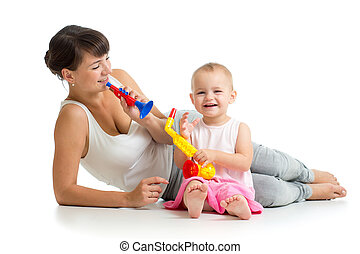 Mother and baby girl having fun with musical toys