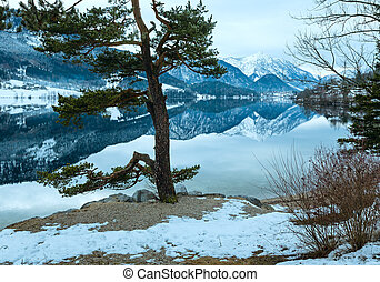 Alpine winter lake view - Cloudy winter Alpine lake...