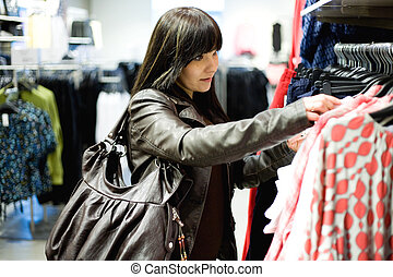 shopping - casual woman watching clothes in store