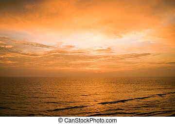 Tranquil sunset over seascape - Tranquil yellow and orange...