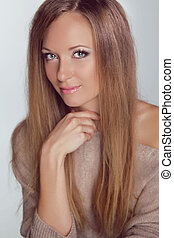 Blond Girl. Beautiful woman with long straight hair. Fashion...