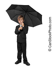 Boy in a tuxedo, under an umbrella. Isolate on white...