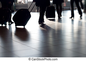people traveling at the airport ( motion blur)