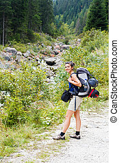 Let us begin the Journey - Hiking lady with big backpack...