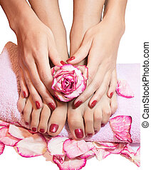 beautiful legs, hands, flowers and petals on towel