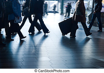 people traveling at the airport motion blur