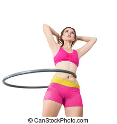 Woman rotates hula hoop - Young woman rotates hula hoop...