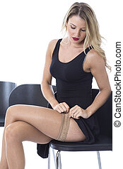 Model Released. Attractive Young Woman Sitting on a Chair...