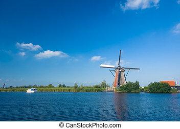 beautiful windmill landscape at kinderdijk in the...