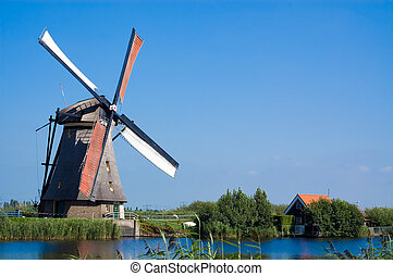 beautiful windmill landscape at kinderdijk in the...